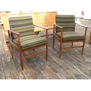 Pair of timber frame chairs, green fabric